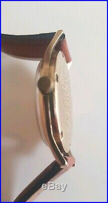 Omega Mens Watch, 9ct gold, with box. 38mm bezel rare find, running cal. 601