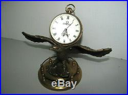 Rare Vintage 1970s Omega Glass Ball Clock Beautifully Mounted On A Brass Eagle